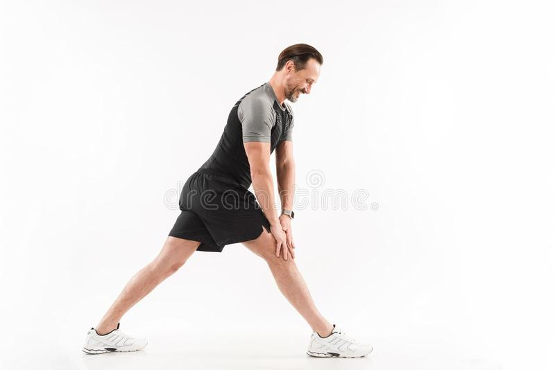Full length portrait of a cheerful mature sportsman royalty free stock images
