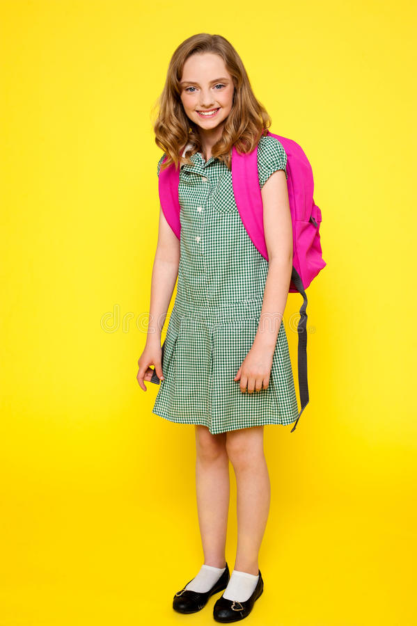 Full length portrait of cheerful school girl stock image