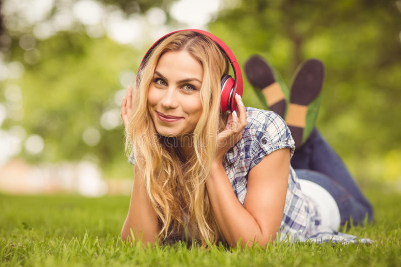 Full length portrait of cheerful woman listening to music stock photos