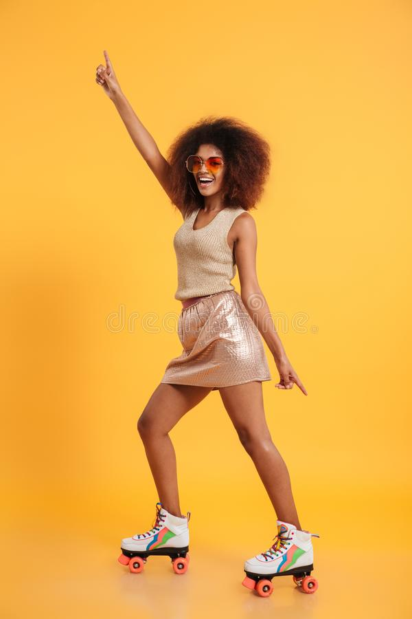 Full length portrait of a cheery afro american woman stock images