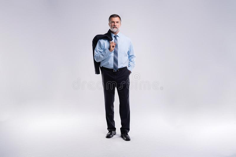 Full length portrait of confident mature businessman in formals standing isolated over white background. royalty free stock photography