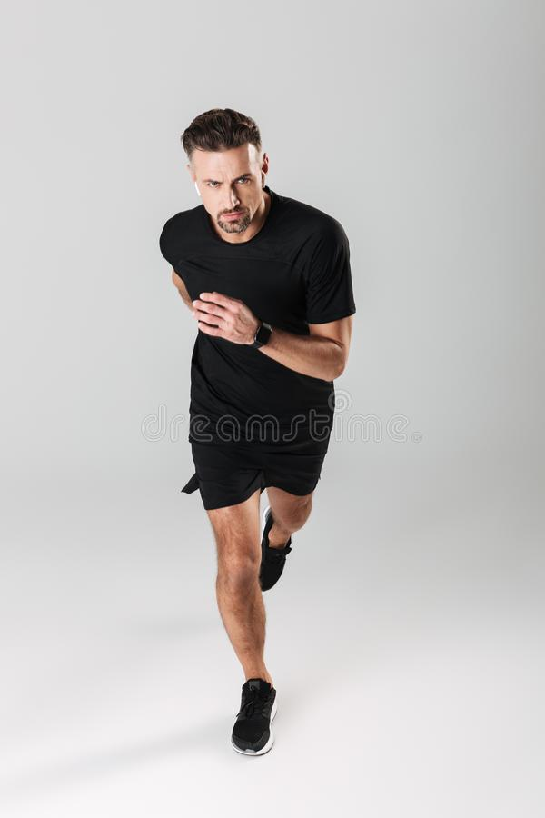Full length portrait of a confident mature sportsman royalty free stock photography