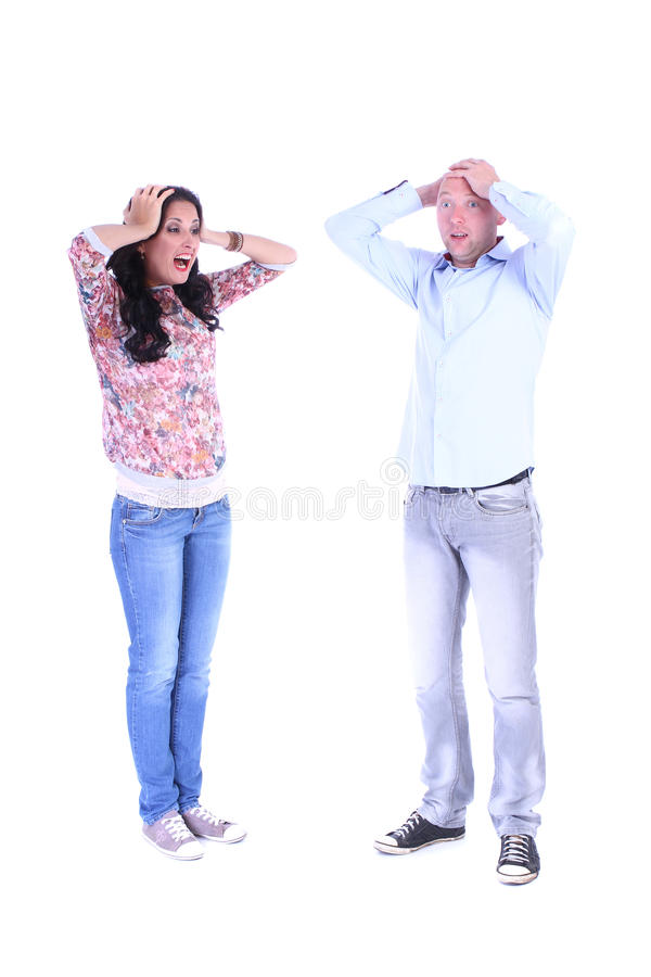 Full length portrait of couple.Desperate man hands clasped. Over white royalty free stock images