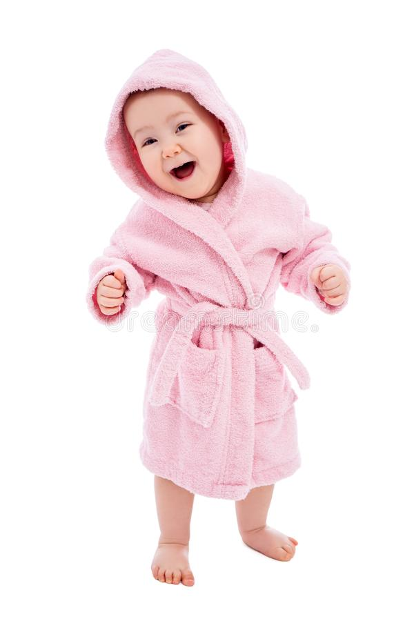 Full length portrait of cute baby girl in pink bathrobe after bath isolated on white. Background royalty free stock image