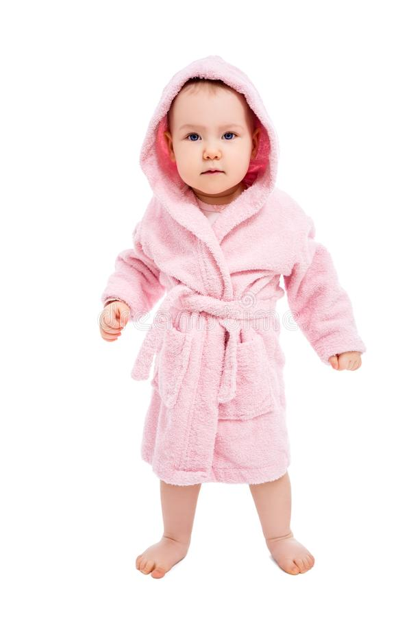Full length portrait of cute baby girl in pink bathrobe posing after bath isolated on white. Background stock photography