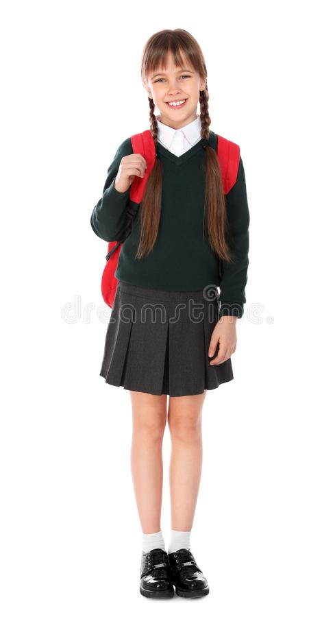 Full length portrait of cute girl in school uniform with backpack stock image