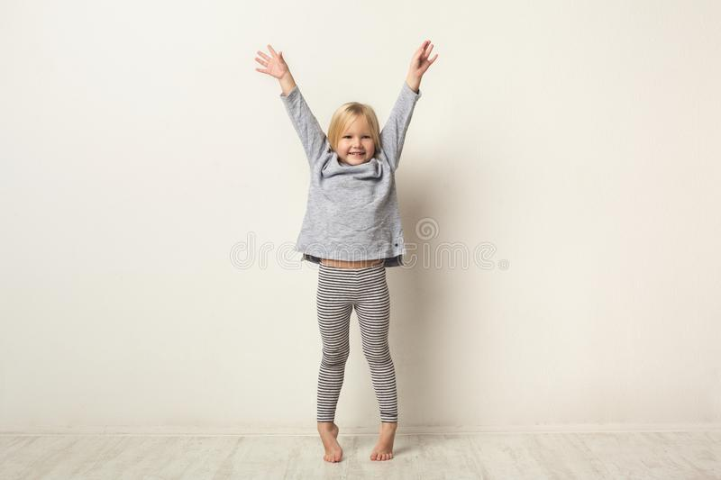 Full-length portrait of cute happy little girl royalty free stock photography