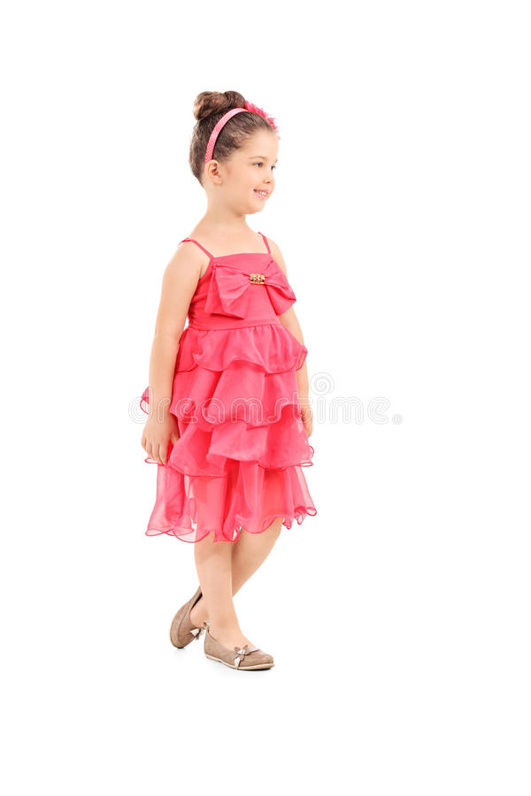 Full length portrait of a cute little girl in red dress stock photo