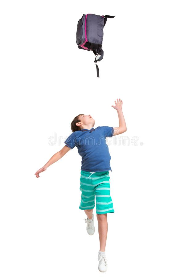 Full length portrait of cute little kid in stylish clothes jumping with bag stock photos
