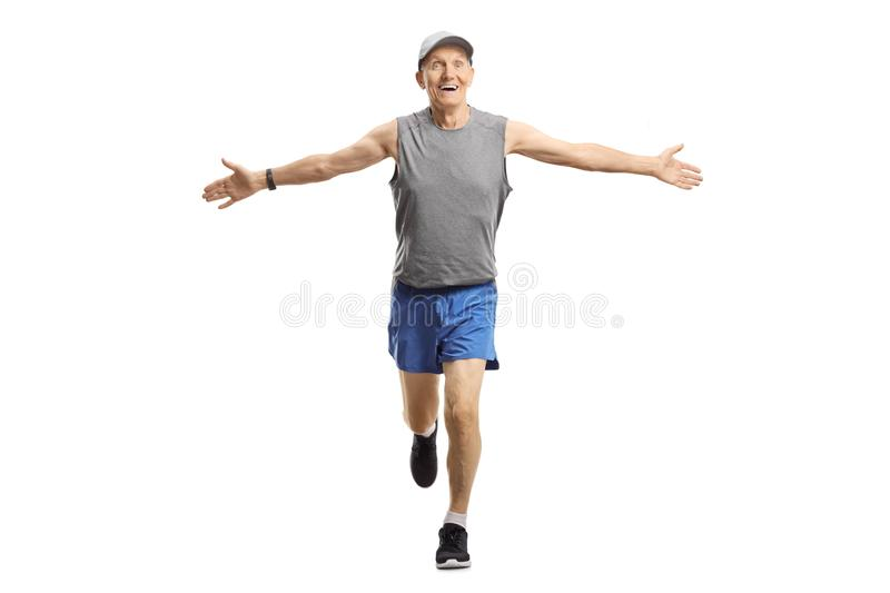 Elderly man running and spreading arms stock photography