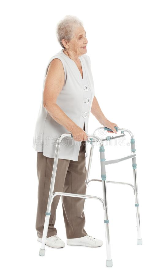 Full length portrait of elderly woman using walking frame isolated royalty free stock photos
