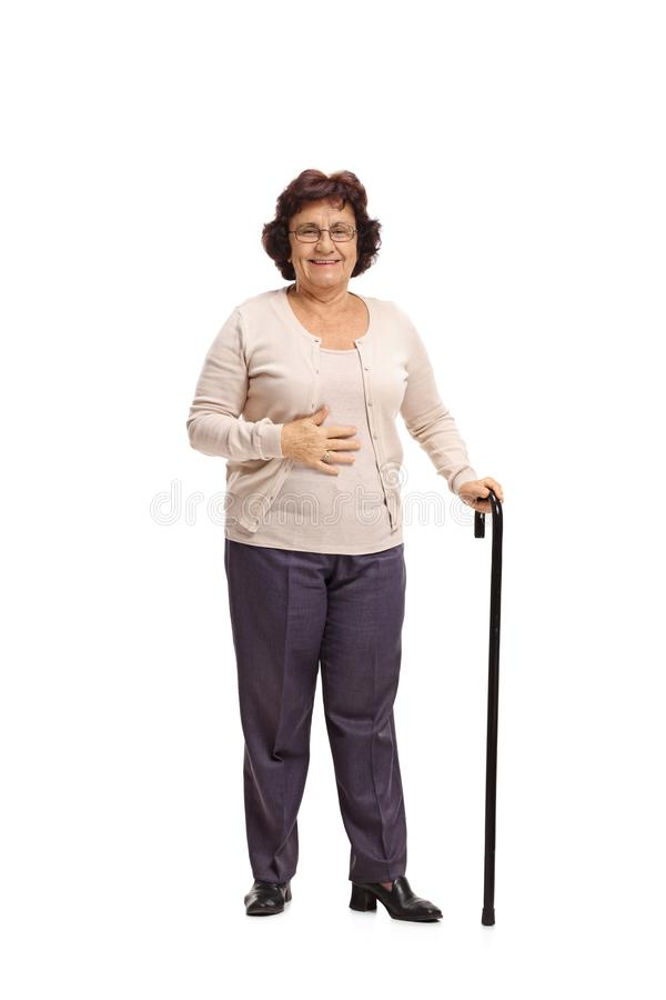 Elderly woman with a walking cane. Full length portrait of an elderly woman with a walking cane isolated on white background royalty free stock photos