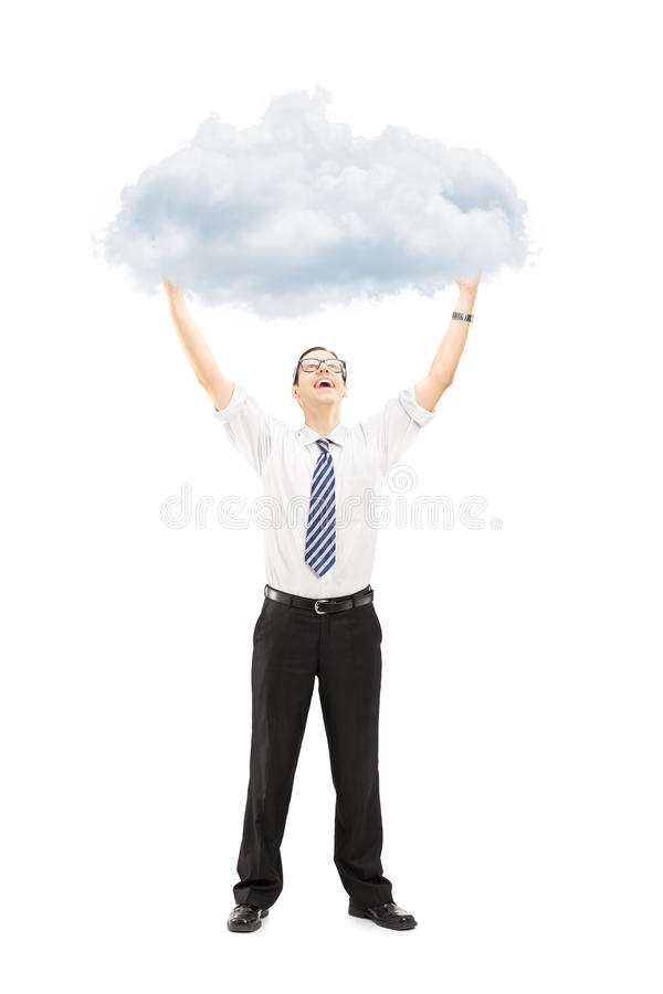 Download Full Length Portrait Of An Excited Young Man Holding A Cloud Stock Photo - Image: 34173174