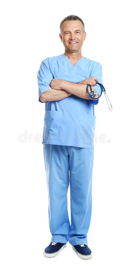 Full length portrait of experienced doctor in uniform on white background royalty free stock photography