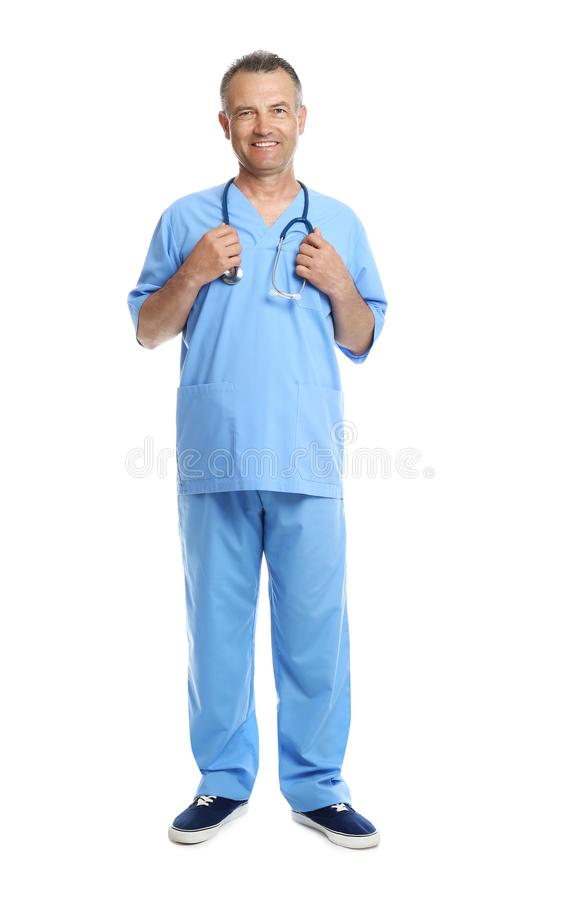 Full length portrait of experienced doctor in uniform on white background royalty free stock images