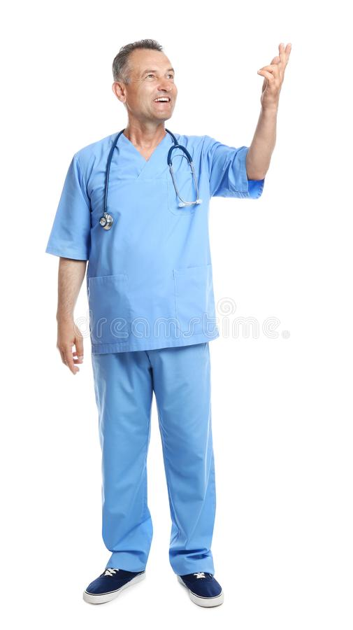 Full length portrait of experienced doctor in uniform on white. Medical service stock photo