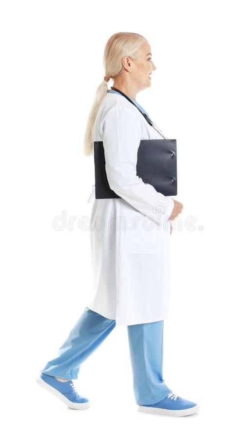 Full length portrait of female doctor with clipboard isolated. Medical staff. Full length portrait of female doctor with clipboard isolated on white. Medical royalty free stock photos