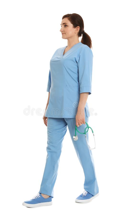 Full length portrait of female doctor in scrubs isolated. Medical staff. Full length portrait of female doctor in scrubs isolated on white. Medical staff stock photography