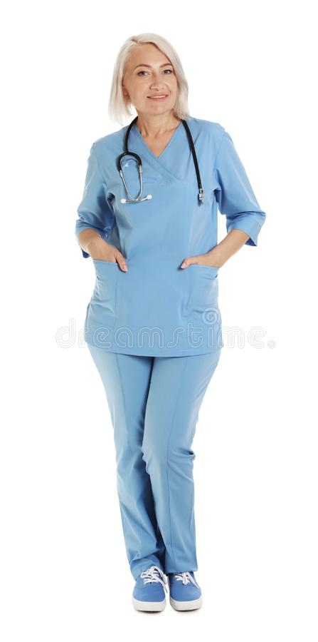 Full length portrait of female doctor in scrubs. Medical staff. Full length portrait of female doctor in scrubs isolated on white. Medical staff stock photography