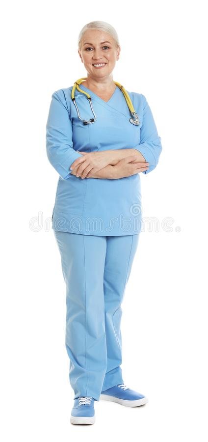 Full length portrait of female doctor in scrubs isolated on white. Medical staff royalty free stock photos