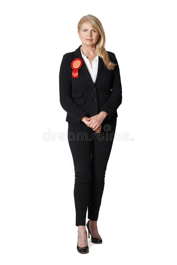 Full Length Portrait Of Female Politician Wearing Red Rosette. Portrait Of Female Politician Wearing Red Rosette royalty free stock photos