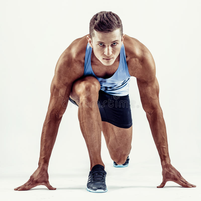 Full length portrait of a fitness man running isolated on a white background stock photography