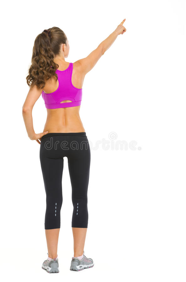 Fitness Young Woman Pointing On Copy Space Royalty Free Stock Image