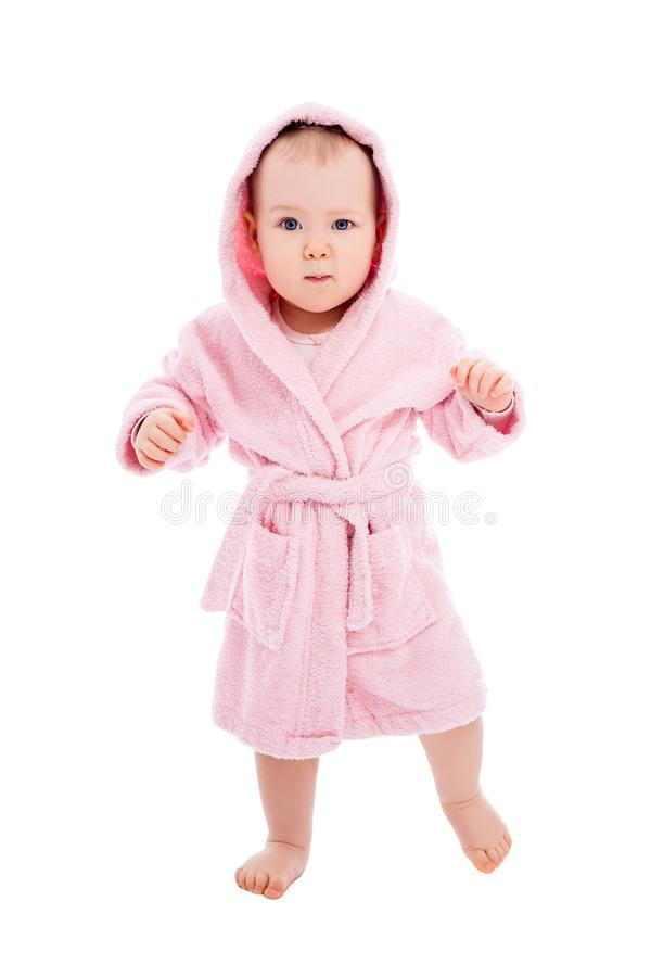 Full length portrait of funny baby girl in pink bathrobe posing after bath isolated on white. Background stock images