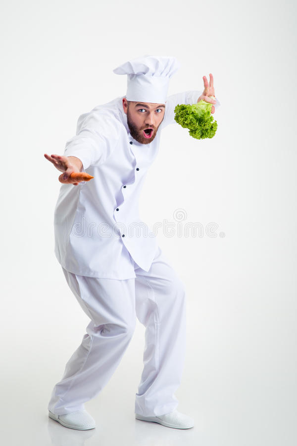 Full length portrait of a funny chef cook dancing. Isolated on a white background stock images