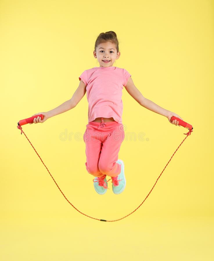 Full length portrait of girl jumping rope royalty free stock images