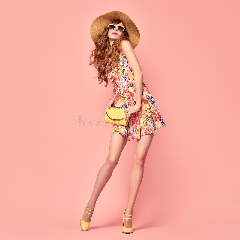 Playful Summer Lady. Floral Dress,Heels. Hairstyle royalty free stock photography
