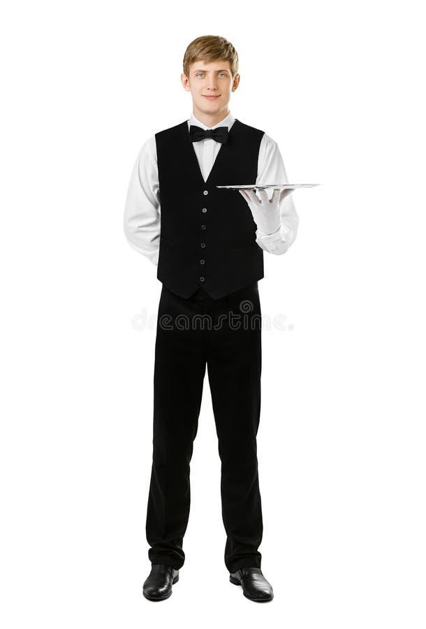 Full length portrait of handsome elegant waiter holding empty tr royalty free stock photos