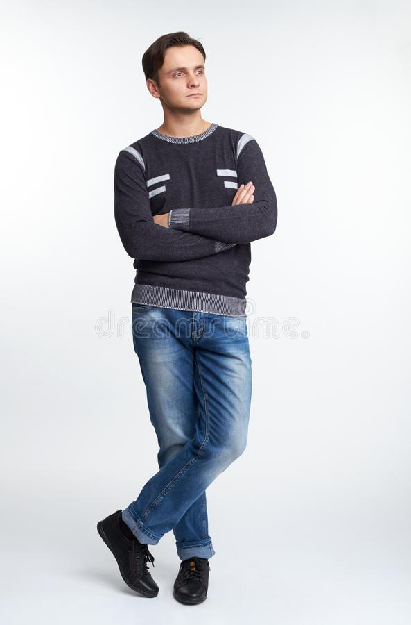 Full length portrait of a handsome guy is wearing casual clothes. Isolated royalty free stock photo