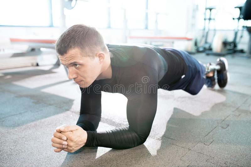Adaptive Sportsman Exercising in Gym royalty free stock photography