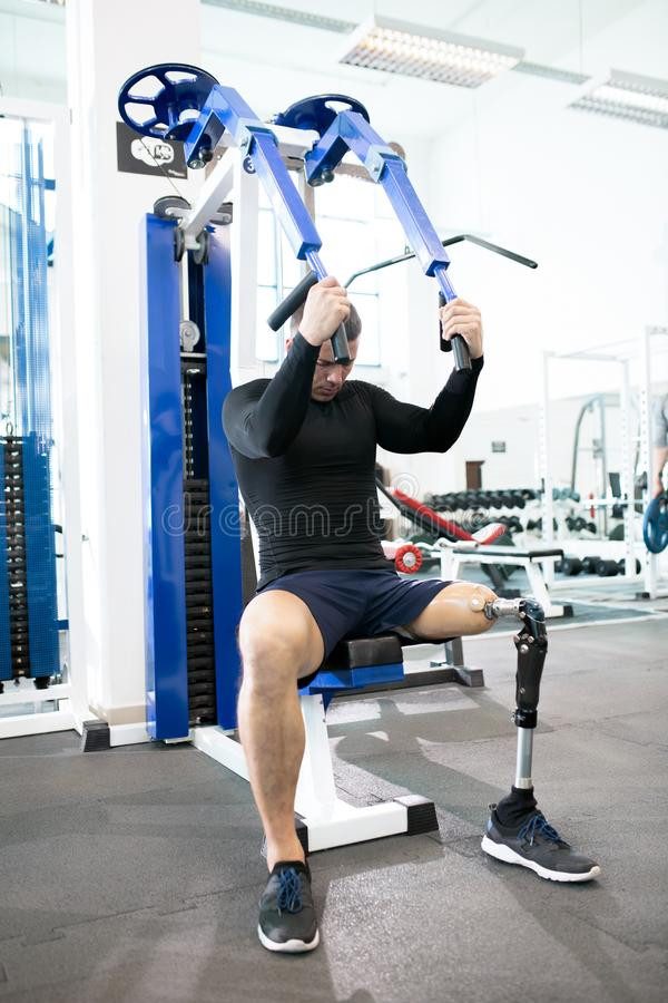 Adaptive Sportsman Using Exercise Machines in Gym royalty free stock photos