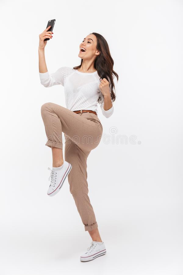 Full length portrait of a happy asian businesswoman celebrating royalty free stock photography