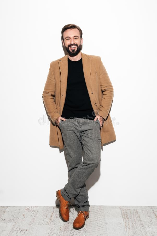 Full length portrait of a happy bearded man royalty free stock photography