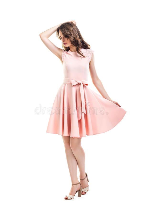 Full length portrait of happy beautiful woman in pink dress isolated on white background stock image