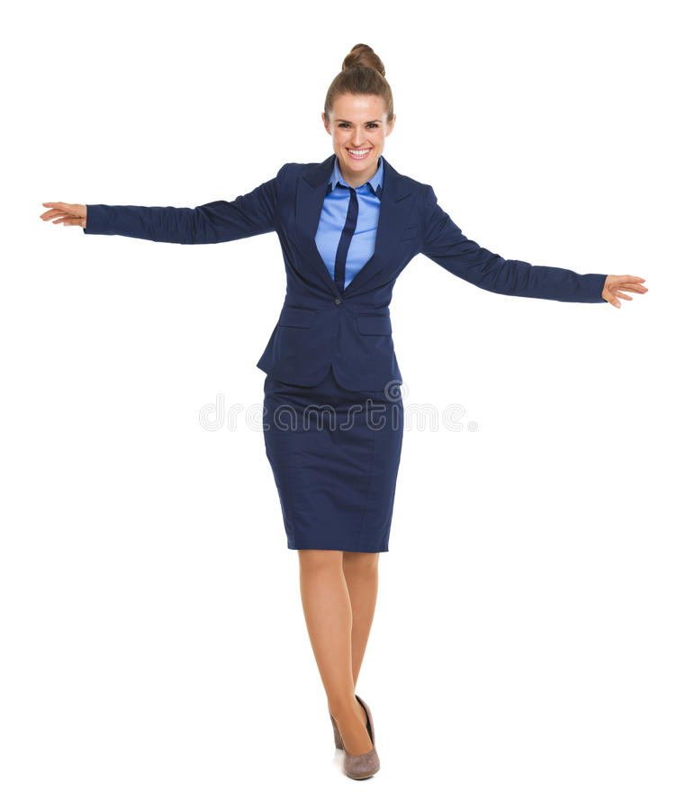 Full length portrait of happy business woman balancing royalty free stock photography