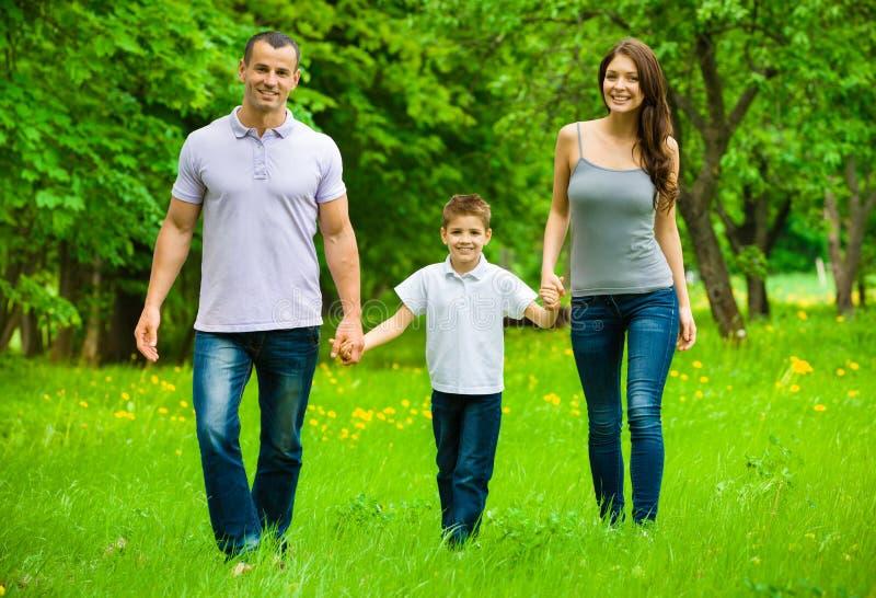 Full-length portrait of happy family of three stock photography