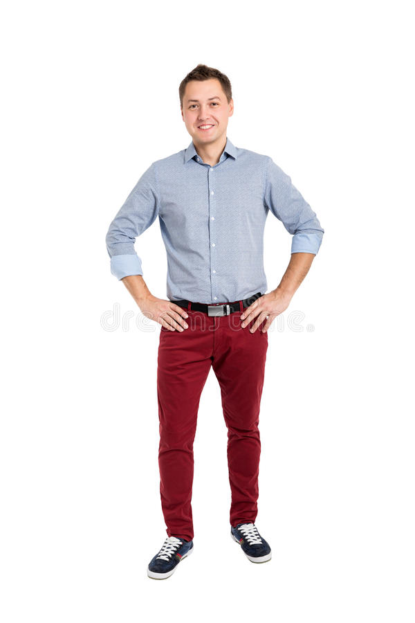 Full length portrait of happy handsome young man stock photo