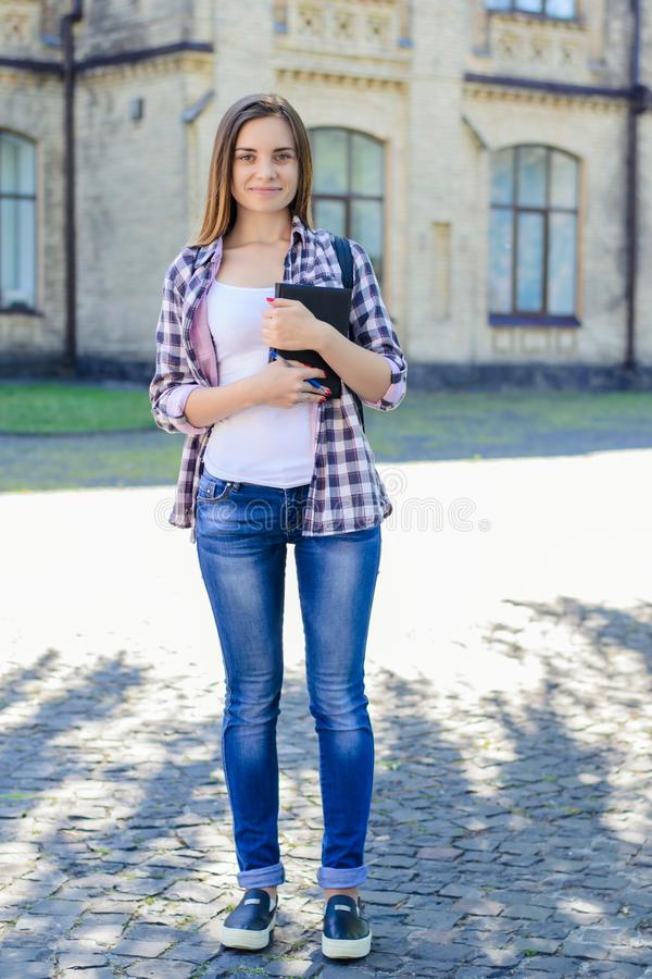 Full-length portrait of happy smiling confident teenage girl in stock image