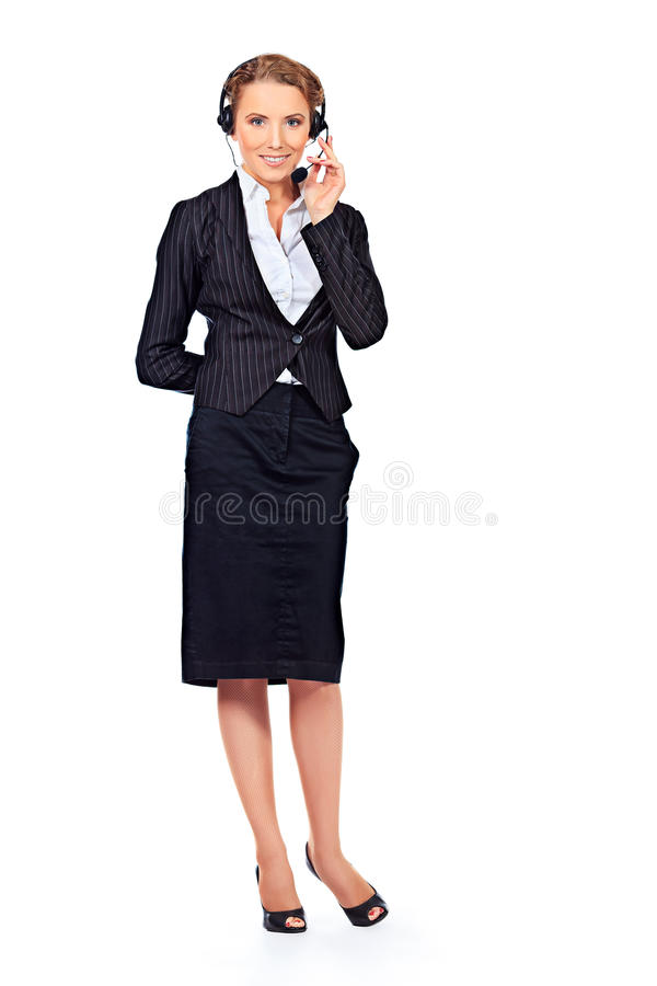 Woman in suit. Full length portrait of a happy smiling support phone operator in headset. Isolated over white royalty free stock images