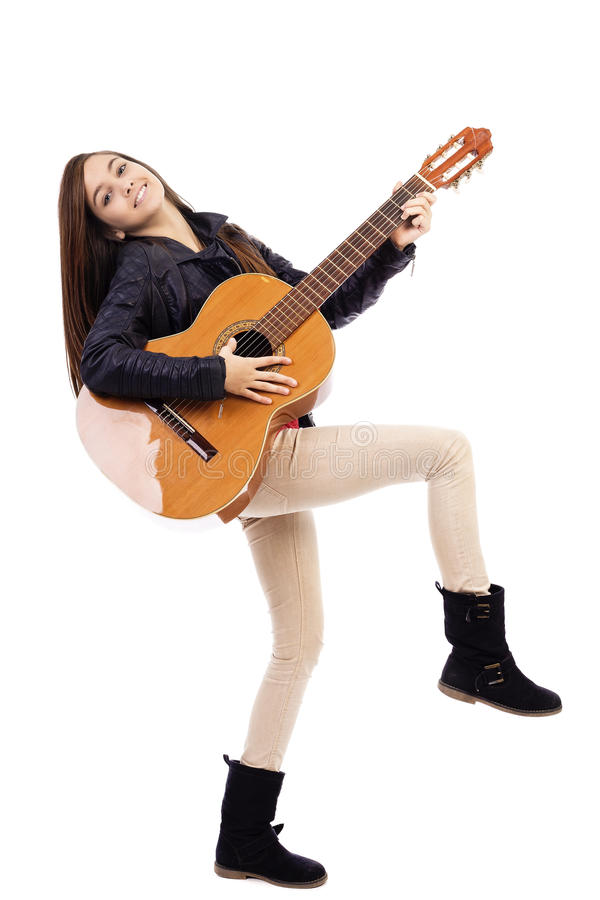 Full length portrait of happy teenage girl playing guitar stock photo