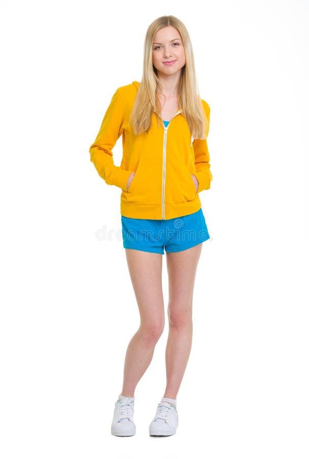 Full length portrait of happy teenager girl. On white stock photo