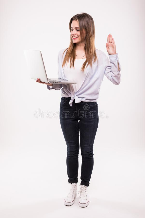 Full length portrait of a happy woman using laptop computer isolated on a white stock images