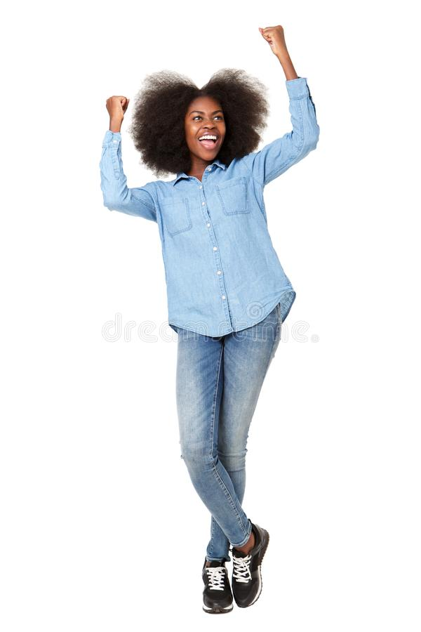 Full length happy young woman cheering with hands raised royalty free stock images
