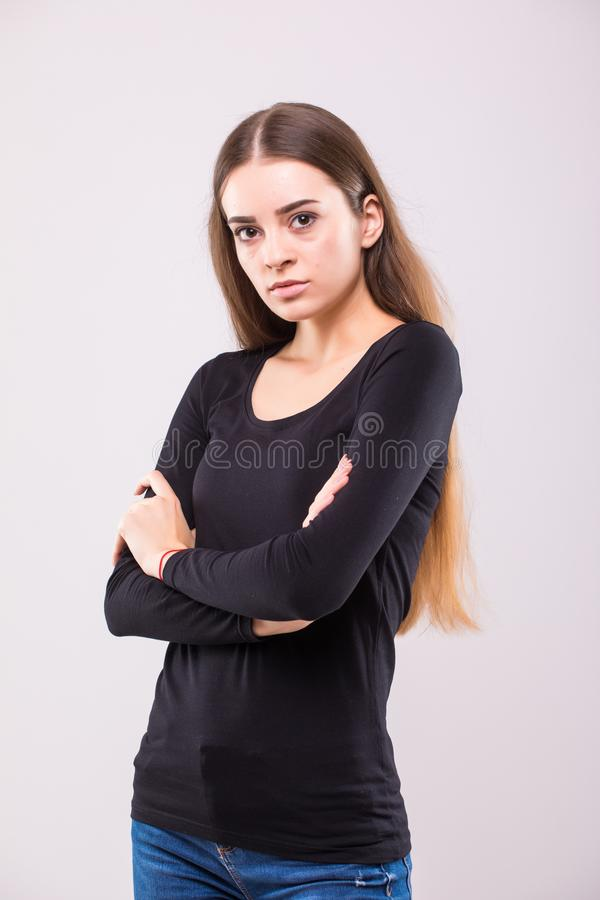 Full length portrait of a happy young woman standing isolated on a white background. Looking at camera stock photos
