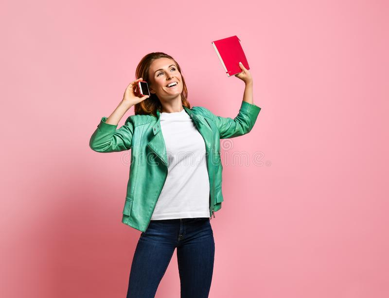 Full length portrait of a happy young woman talking on the phone royalty free stock photography