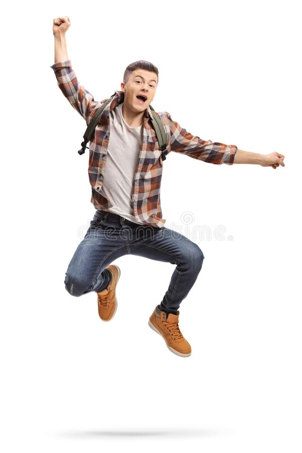 Full length portrait of a joyful teenage student jumping stock photo